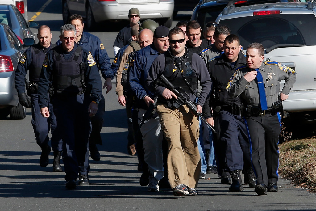 . Police patrol the streets outside Sandy Hook Elementary School after a shooting in Newtown, Connecticut, December 14, 2012. At least 27 people, including children, were killed on Friday when at least one shooter opened fire at an elementary school in Newtown, Connecticut, CBS News reported, citing unnamed officials.    REUTERS/Adrees Latif