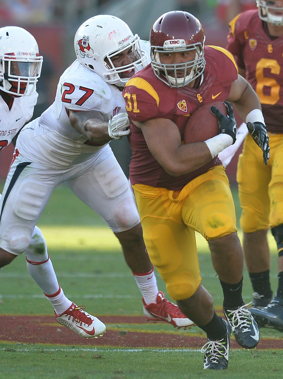 . USC #31 Soma Vainuku gets past Fresno #27 Donavon Lewis in the 2nd half. USC played Fresno State at the Los Angeles Memorial Coliseum for the first game of the year. Los Angeles, CA. 8/30/2014(Photo by John McCoy Daily News