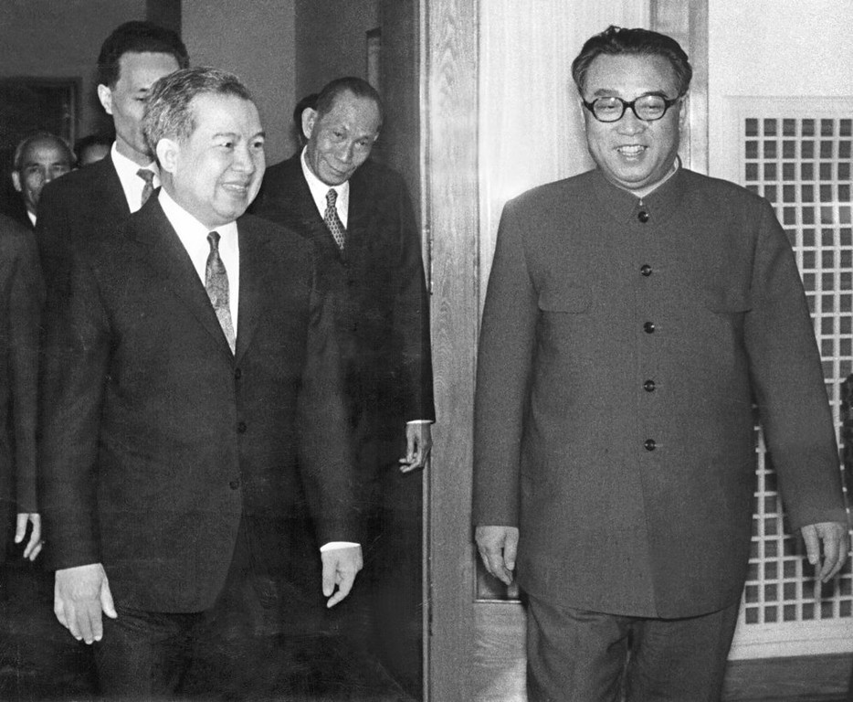 ". Norodom Sihanouk, former King of Cambodia (l) is welcomed 22 April 1975 in Pyongyang by North Korean President and ""Great Leader\"" Kim Il-Sung (r). Sihanouk was deposed 18 March 1970 by forces of Lt-Gen. Lon Nol. The ostensible motive for the coup was Sihanouk\'s alleged collaboration with the Vietnamese communist revolutionaries who used Cambodian territory for sanctuaries. Informed of the coup while on a diplomatic mission, Prince Sihanouk formed an alliance with North Viet Nam and with an underground Marxist insurgency group, the Khmers Rouges, led by Pol Pot. (Photo credit should read AFP/Getty Images)"