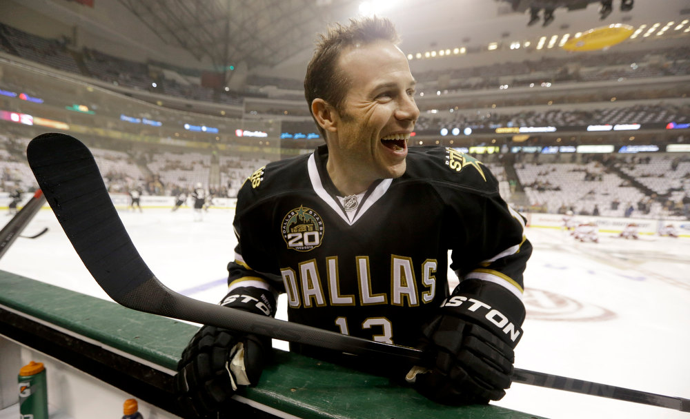 Description of . Dallas Stars left wing Ray Whitney (13) laughs as he warms up before the NHL hockey game against the Phoenix Coyotes Saturday, Jan. 19, 2013, in Dallas. (AP Photo/LM Otero)