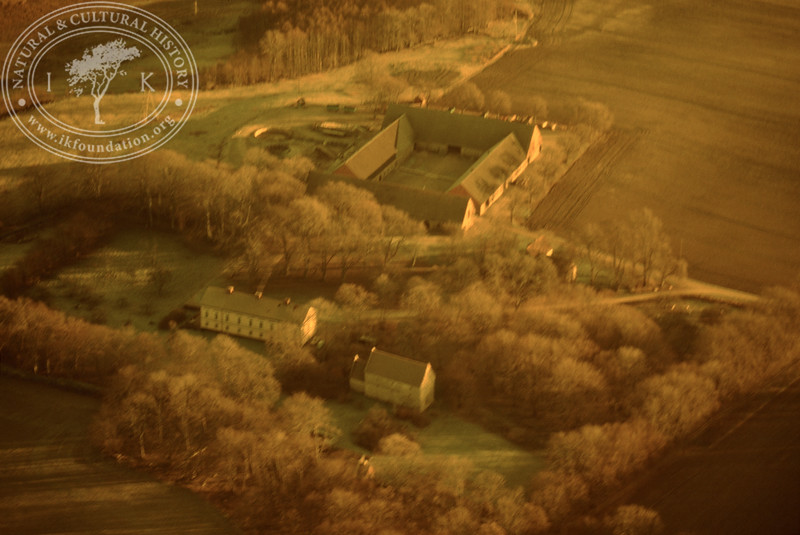 Araslöv manor house and church with farmland. Experimentally photographed with yellow filter (19 November, 1988). | LH.0231