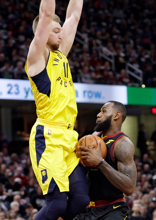 . Cleveland Cavaliers\' LeBron James, right, is stopped by Indiana Pacers\' Domantas Sabonis, from Lithuania, in the first half of a first-round playoff series in an NBA basketball game, Sunday, April 15, 2018, in Cleveland. (AP Photo/Tony Dejak)