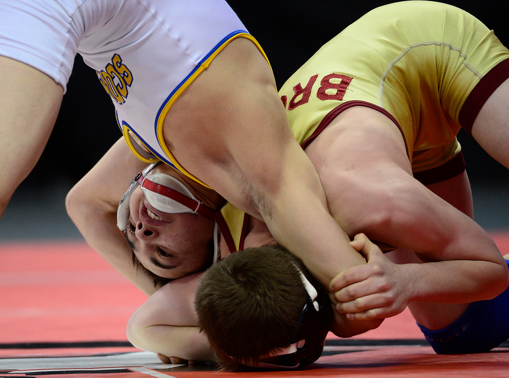 . Brendon Garcia places Caleb Cox in a hold while they battle it out for the Class 3A 106 pound championship during the finals of the 2016 Colorado Wrestling State Championships at the Pepsi Center on February 20, 2016 in Denver, Colorado. Brendon Garcia of Dolores Huerta defeated Caleb Cox of Brush to take first place in 106 in Class 3A. (Photo by Brent Lewis/The Denver Post)