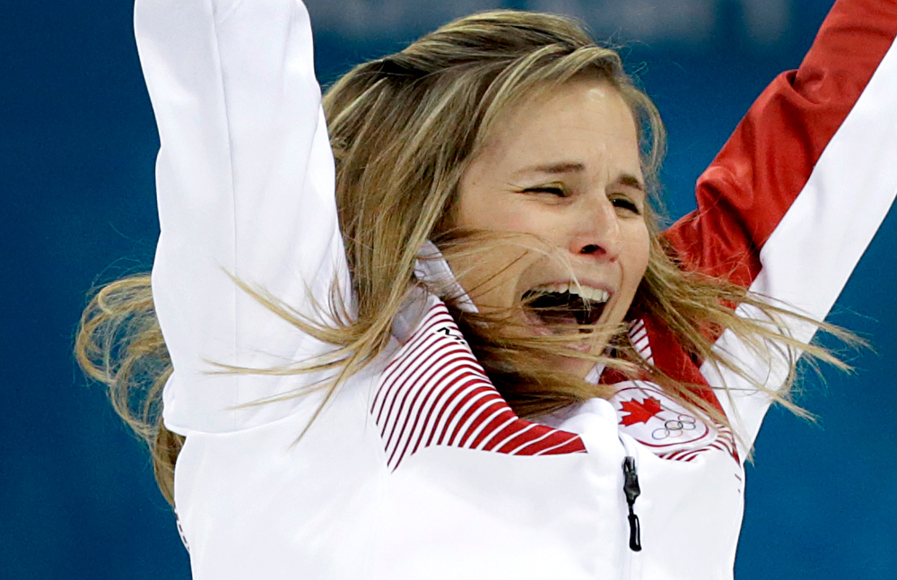 . Canada\'s skip Jennifer Jones celebrates after winning the women\'s curling gold medal game against Sweden at the 2014 Winter Olympics, Thursday, Feb. 20, 2014, in Sochi, Russia. (AP Photo/Wong Maye-E)