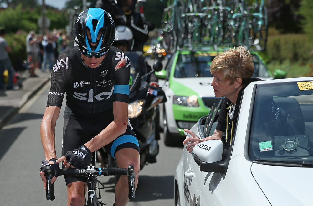 Description of . Chris Froome of Great Britain and Team Sky receives medical attention after being involved in a crash early in the race during stage four of the 2014 Le Tour de France from Le Touquet-Paris-Plage to Lille on July 8, 2014 in Le Touquet-Paris-Plage, France.  (Photo by Doug Pensinger/Getty Images)
