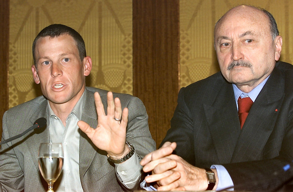 . Two-time Tour de france winner Lance Armstrong, of Austin, Texas, gestures during a news conference in Paris, Monday April 9, 2001, as his lawyer Georges Kiejman, of France, looks on. Armstrong said Monday that French officials investigating his U.S. Postal cycling team have found no evidence of doping in urine samples tested so far. Officials are looking into whether Armstrong\'s team may have used banned performance-enhancing substances during the 2000 Tour, which Armstrong won for the second straight year.  (AP Photo/Laurent Rebours)