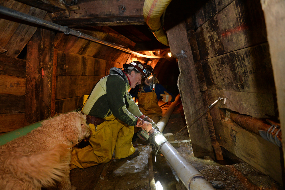 . Miner Tom Hendricks, middle, works on some pipes inside the Cross Mine with miner Justin Short, right, at Caribou in Nederland, Co on January 24, 2014.  (Photo By Helen H. Richardson/ The Denver Post)