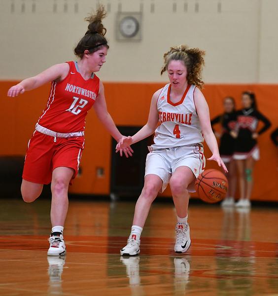 12/26/2019 Mike Orazzi | Staff\rTerryville High School's Zoe Zappone (4) and Northwestern's Morgan Piitt (12) during Thursday's girls basketball game in Terryville. \r