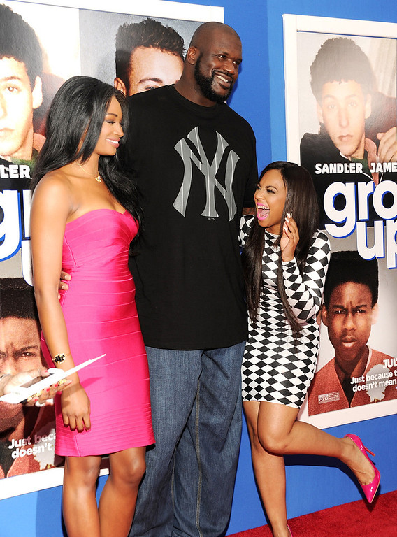 """. Retired basketball player Shaquille O\'Neal, center, poses with former Miss USA Nana Meriwether, left, and singer Ashanti Douglas at the premiere of \""""Grown Ups 2\"""" at the AMC Loews Lincoln Square on Wednesday, July 10, 2013 in New York. (Photo by Evan Agostini/Invision/AP)"""