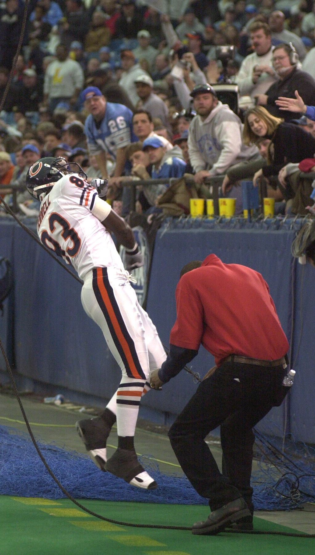 . David Terrell (83) of the Chicago Bears throws the ball into the stands after scoring a touchdown in the first half of action against the Detroit Lions during Sunday\'s game played at the Pontiac Silverdome on Sunday Dec. 30, 2001. The Bears won 24-0 over the Lions.