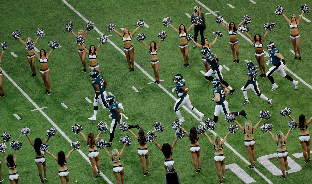 . Members of the Philadelphia Eagles run on to the field before the NFL Super Bowl 52 football game against the New England Patriots, Sunday, Feb. 4, 2018, in Minneapolis. (AP Photo/Eric Gay)