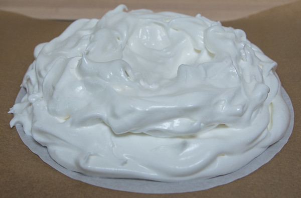 Meringue mounded on parchment round