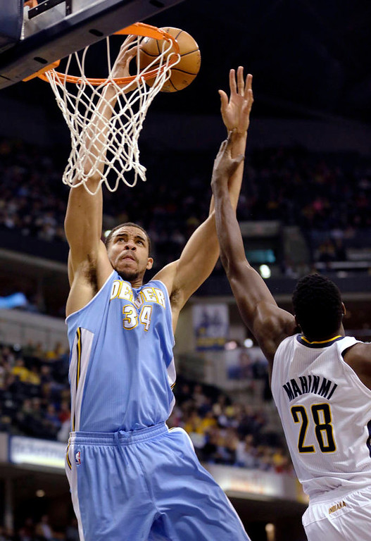 . Denver Nuggets center JaVale McGee, left, is fouled by Indiana Pacers center Ian Mahinmi during the first half of an NBA basketball game in Indianapolis, Friday, Dec. 7, 2012. (AP Photo/AJ Mast)