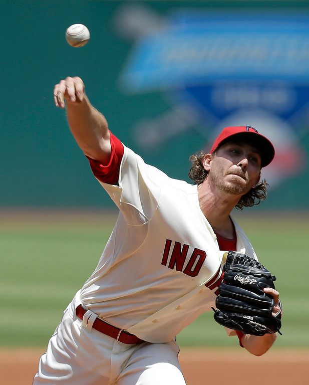 . Cleveland Indians starting pitcher Josh Tomlin delivers in the first inning of a baseball game against the Colorado Rockies, Sunday, June 1, 2014, in Cleveland. (AP Photo/Tony Dejak)