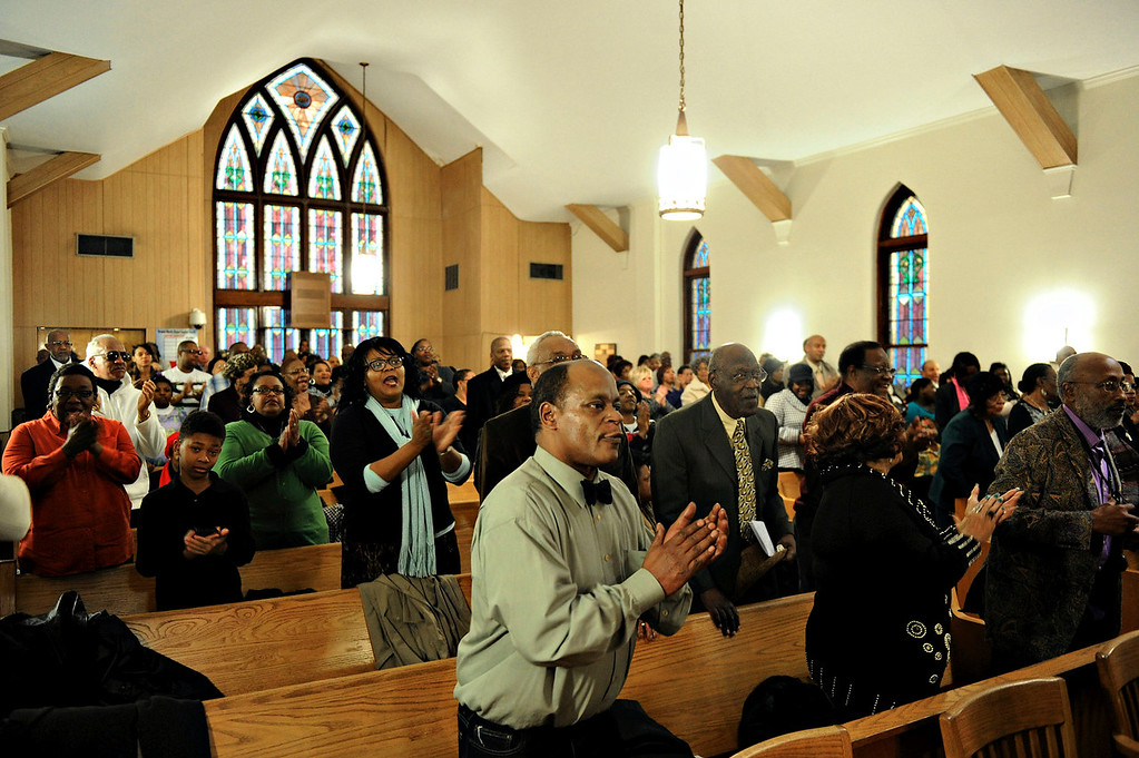 . People stand and clap during the music portion of the Black History Committee\'s celebration of Dr. Martin Luther King, Jr\'s birthday at Greater Norris Chapel Baptist Church in Henderson, Ky Sunday Jan. 19, 2014. (AP Photo/The Gleaner, Darrin Phegley)