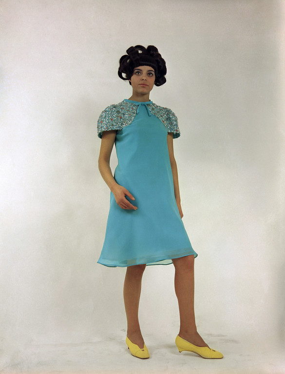 . A cocktail dress of turquoise chiffon, with richly embroidered sleeves, by Renato Balestra of Rome fashions Italian dress, Jan. 21, 1967. (AP Photo/Mario Torrisi)