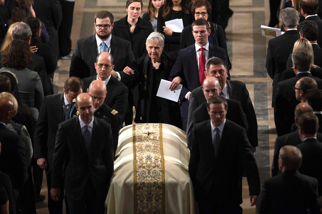 . The widow, Maureen McCarthy Scalia, walks behind the casket as it is lead out of church following the funeral Mass for US Supreme Court Justice Antonin Scalia at the Basilica of the National Shrine of the Immaculate Conception in Washington, DC,  on February 20, 2016.  / AFP / POOL / Doug MILLS/AFP/Getty Images