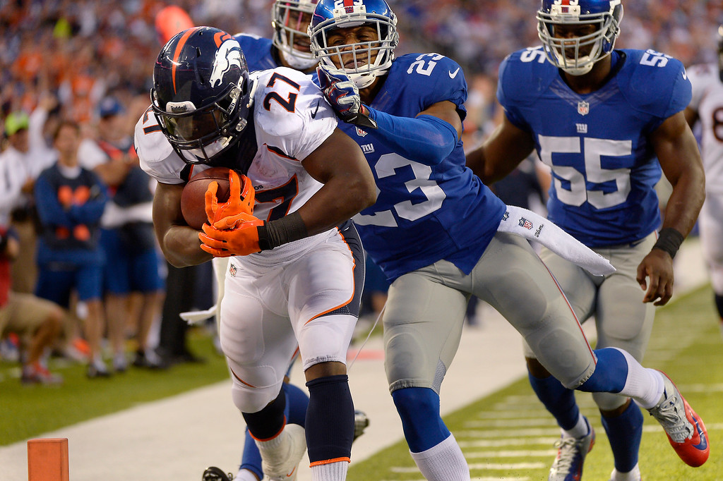 . September 15: Running back Knowshon Moreno (27) of the Denver Broncos breaks free for a touchdown and makes the score 23-16 with seconds left in the 3rd quarter vs the New York Giants at METLIFE Stadium. September 15, 2013 East Rutherford, NJ. (Photo By Joe Amon/The Denver Post)