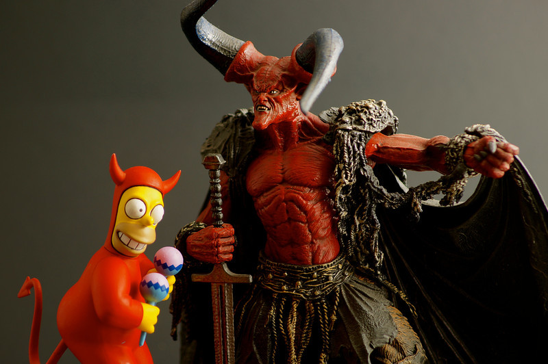 Homer Simpson and Tim Curry's Devil (from Legend)