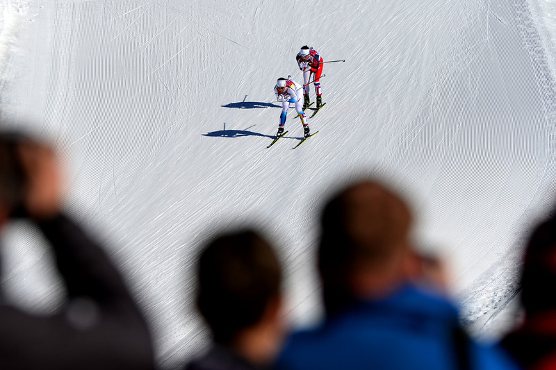. Charlotte Kalla of Sweden leads Marit Bjoergen of Norway as they descend towards the finish line during the Ladies\' Skiathlon 7.5 km Classic + 7.5 km Free during day one of the Sochi 2014 Winter Olympics at Laura Cross-country Ski & Biathlon Center on February 8, 2014 in Sochi, Russia.  (Photo by Harry How/Getty Images)