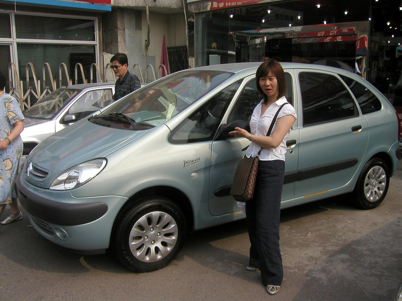 I'll drive this one, Helen, Beijing car dealership, June 2004