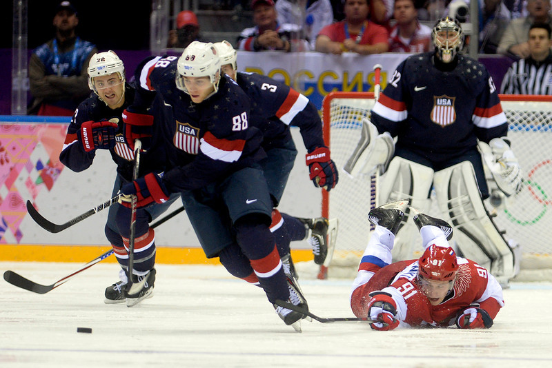 . Vladimir Tarasenko (91) of the Russia loses his balance as Patrick Kane (88) of the U.S.A. takes control during  the third period of the U.S.A.\'s shootout-win at Bolshoy arena. Sochi 2014 Winter Olympics on Saturday, February 15, 2014. (Photo by AAron Ontiveroz/The Denver Post)