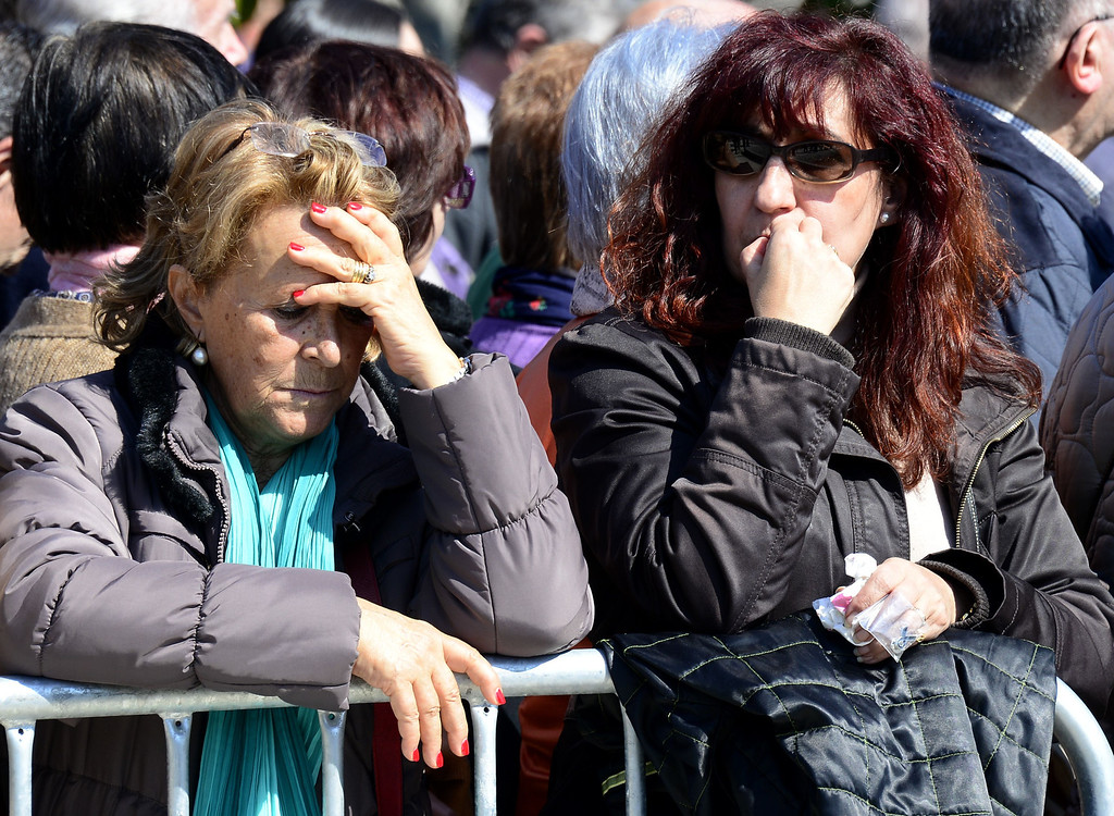 . People mourn during a commemoration ceremony in held in the Rememberance Garden of Madrid\'s Retiro Park on March 11, 2014 for the victims of the Madrid train bombings marking the10th year anniversary of the attacks that claimed 191 lives and injured more than 1800 others. On March 11, 2004 at 7:40 am, 10 bombs exploded on board four packed commuter trains in Madrid in an attack claimed by the Al-Qaeda terror network, which said they were punishment for Spain\'s role in the US-led invasion of Iraq. JAVIER SORIANO/AFP/Getty Images