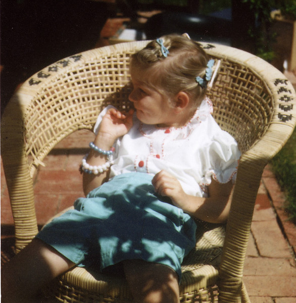 This is me, I think I am about four years old. Bad posture started at an early age...