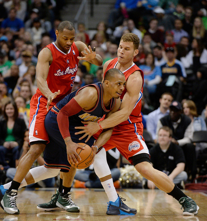 . Denver Nuggets guard Randy Foye (4) gets double teamed by Los Angeles Clippers guard Willie Green (34) and Los Angeles Clippers forward Blake Griffin (32) during the third quarter. (Photo by John Leyba/The Denver Post)