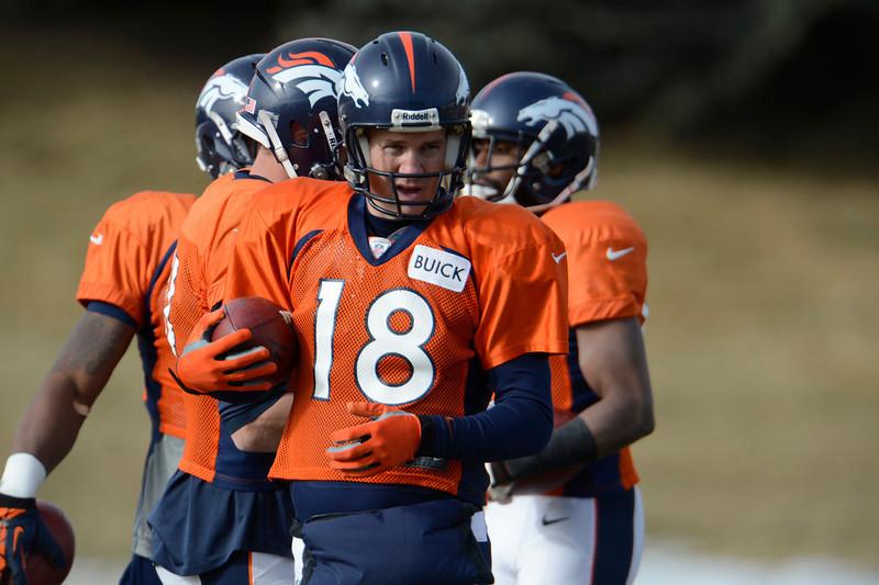 . Denver Broncos quarterback Peyton Manning (18) runs through drills during practice Wednesday, January 8, 2013 at Dove Valley.  John Leyba, The Denver Post