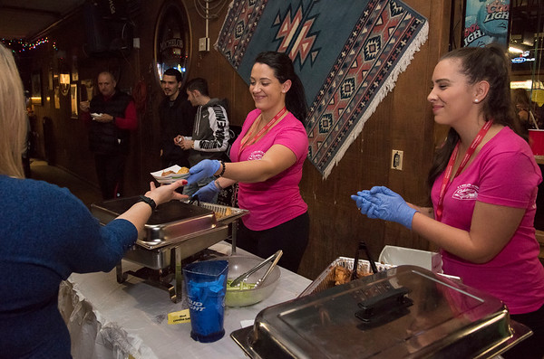 11/19/19 Wesley Bunnell   StaffrrCourtney Smith, L, and Chelsea Rouelle served up wings for sample representing the home team at the Cadillac Ranch during the Southington Chamber of Commerce's annual WingFest at the Cadillac Ranch on Monday night November 18 , 2019.
