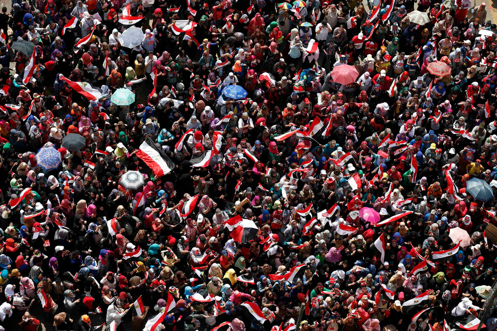 . Protesters, who are against Egyptian President Mohamed Mursi, gather in Tahrir Square in Cairo July 3, 2013. Egyptian troops with armoured vehicles have secured the central Cairo studios of state television on Wednesday, security sources said. As a deadline approaches when the army high command is expected to step in and reorder Egypt\'s political institutions, the sources said staff not involved in working on live broadcasts had left the building. REUTERS/Steve Crisp