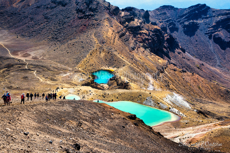Looking down at the green colours of the Emerald Lakes from the Red Crater at the peak of the Tongariro Alpine crossing