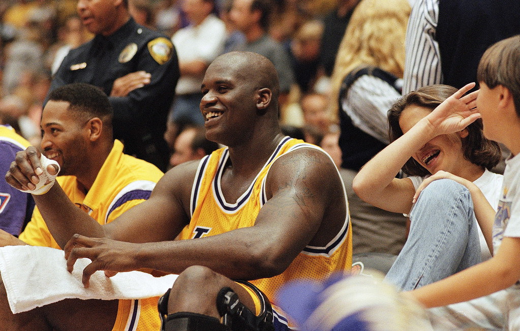 . Shaquille O?Neal, right, smiles with teammate Robert Horry after coming out of the game in the final minutes of the Los Angeles Lakers? 107-93 victory over the Portland Trail Blazers to take a 2-0 lead in their best-of-five playoff series, April 27, 1997 in Inglewood, Calif. (AP Photo/Reed Saxon)