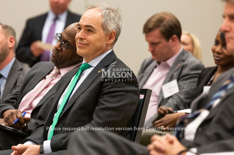 George Mason University president Dr. Ángel Cabrera listens to a panel discussion about Amazon's selection of Arlington for a second headquarters held by the Metropolitan Washington Council of Governments hosted by George Mason.  Photo by Lathan Goumas/Strategic Communications
