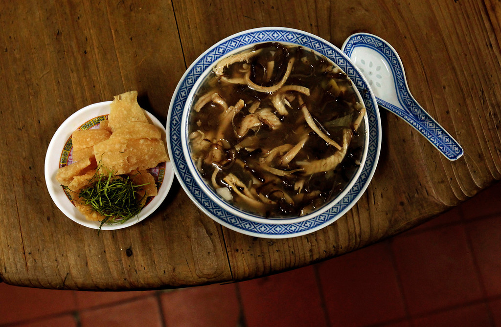 . Snake meat is seen in a bowl of snake soup served at a snake soup shop in Hong Kong January 30, 2013. There are scores of people in Hong Kong who have through generations tamed snakes to make soup out of them, a traditional cuisine believed to be good for the health. Yet the people behind providing fresh snakes for the savory meal thought to speed up the body\'s blood flow and keep it strong in the cold winter months may be doomed, with young people increasingly reluctant to take on a job they see as hard and dirty. Picture taken January 30, 2013. REUTERS/Bobby Yip