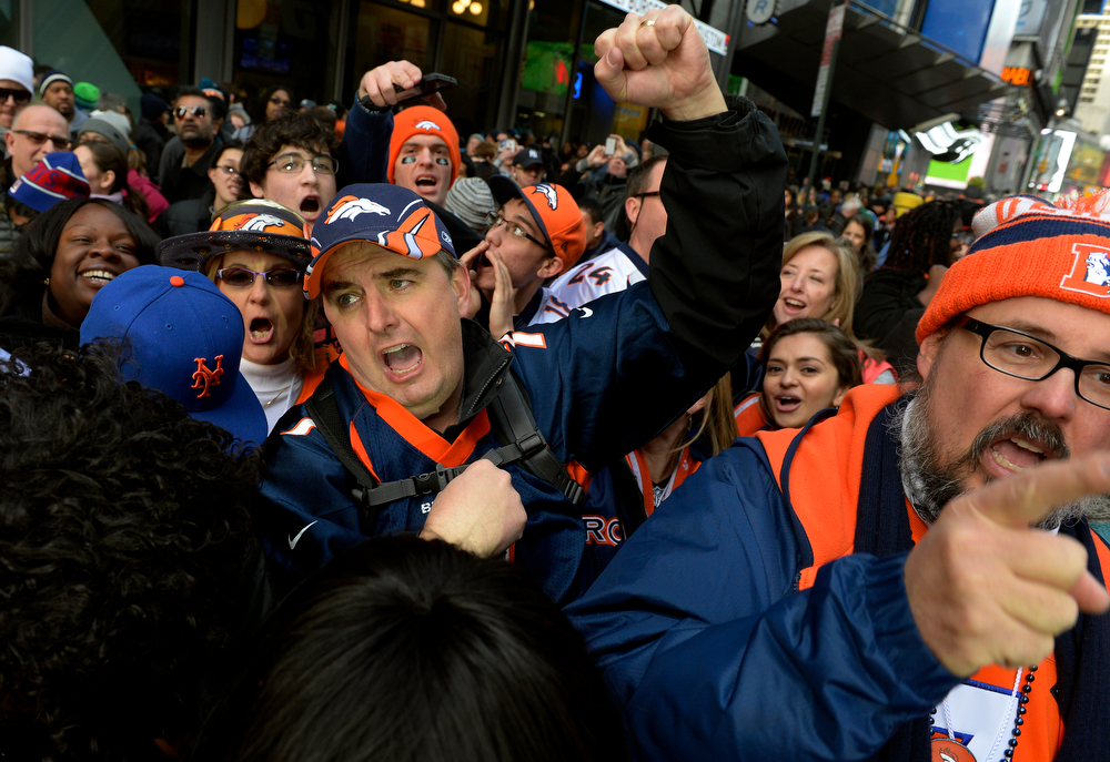 . David Palmer, of Centennial, CO, cheers for the Broncos while watching the Press Box Tailgating Show on Super Bowl Boulevard in New York, NY February 02, 2014. The NFL has transformed 13 blocks of Broadway into a center for Super Bowl activity before Sundays Super Bowl between the Denver Broncos and Seattle Seahawks. Palmer predicted a 34-16 Broncos victory.  (Photo By Craig F. Walker / The Denver Post)