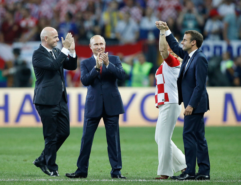 . President of Croatia, Kolinda Grabar-Kitarovic, second right with the President of France Emmanuel Macron, right, with President of Russia Vladimir Putin, and President of FIFA Gianni Infantino, left, on the pitch after the end of the final match between France and Croatia at the 2018 soccer World Cup in the Luzhniki Stadium in Moscow, Russia, Sunday, July 15, 2018. France won the game 4-2. (AP Photo/Francisco Seco)