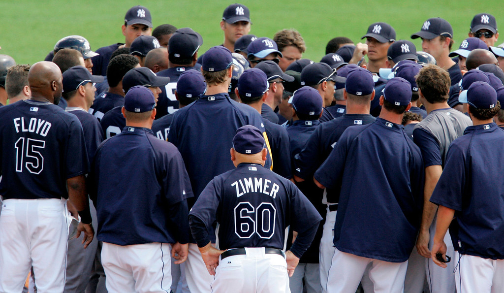 . Tampa Bay Rays senior advisor Don Zimmer (60) watches as a second inning brawl with the New York Yankees sorts itself out in spring baseball action in St. Petersburg, Fla.,  Wednesday, March 12, 2008.(AP Photo/Gene J. Puskar)