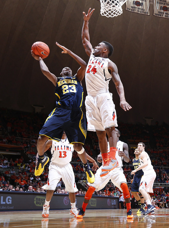 . CHAMPAIGN, IL - MARCH 4:  Caris LeVert #23 of the Michigan Wolverines drives to the basket against Rayvonte Rice #24 of the Illinois Fighting Illini during the game at State Farm Center on March 4, 2014 in Champaign, Illinois. Michigan defeated Illinois 84-53. (Photo by Joe Robbins/Getty Images)