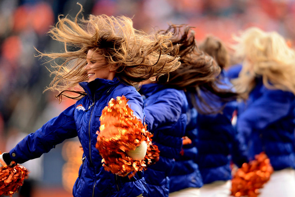Description of . Denver Broncos cheerleaders dance during the first half of the game.  The Denver Broncos vs Baltimore Ravens AFC Divisional playoff game at Sports Authority Field Saturday January 12, 2013. (Photo by John Leyba,/The Denver Post)