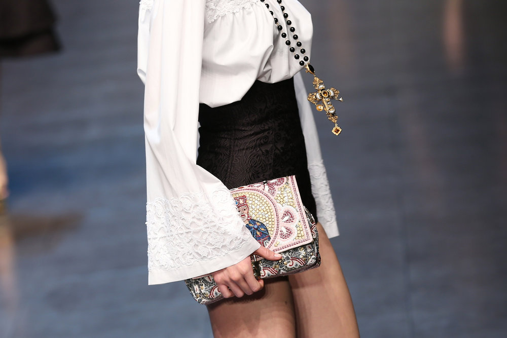 Description of . A detail of a model is seen as she walks the runway at the Dolce & Gabbana fashion show as part of Milan Fashion Week Womenswear Fall/Winter 2013/14 on February 24, 2014 in Milan, Italy.  (Photo by Vittorio Zunino Celotto/Getty Images)