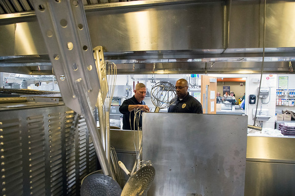 01/30/20 Wesley Bunnell | StaffrrThe annual SOUPerBowl to benefit the Friendship Centers Soup Kitchen took place on Thursday Jan 30, 2020 at E.C. Goodwin Technical School. New Britain Fire Inspectors Joe Dicicco and Ryan Stewart stand opposite large industrial kitchen appliances and utensils.