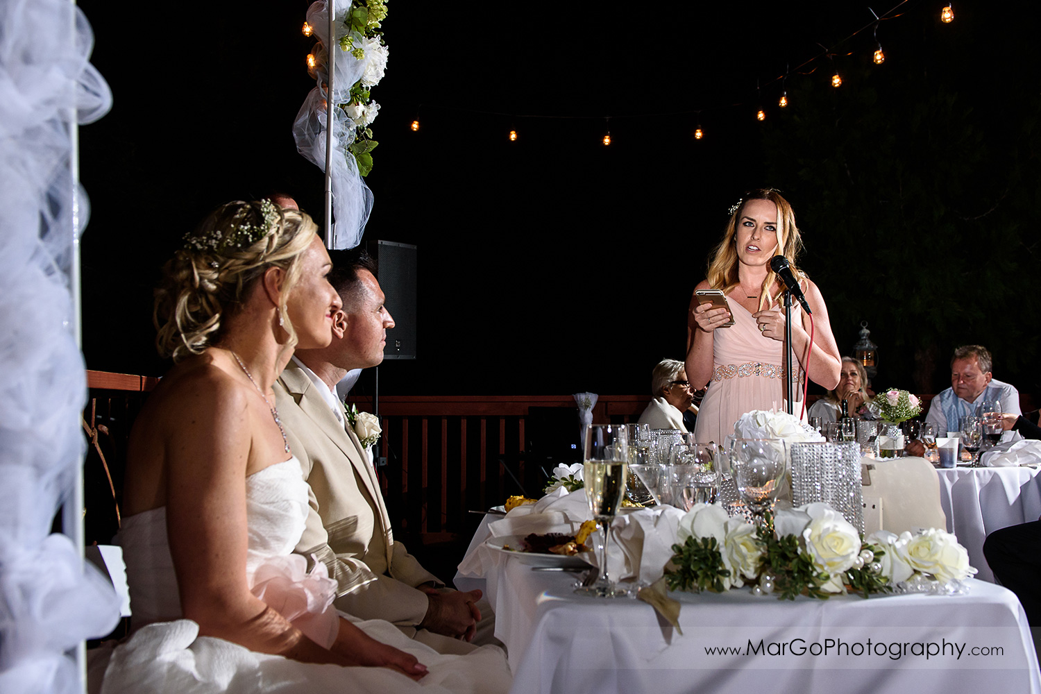 maid of honor giving a speech during backyard wedding reception