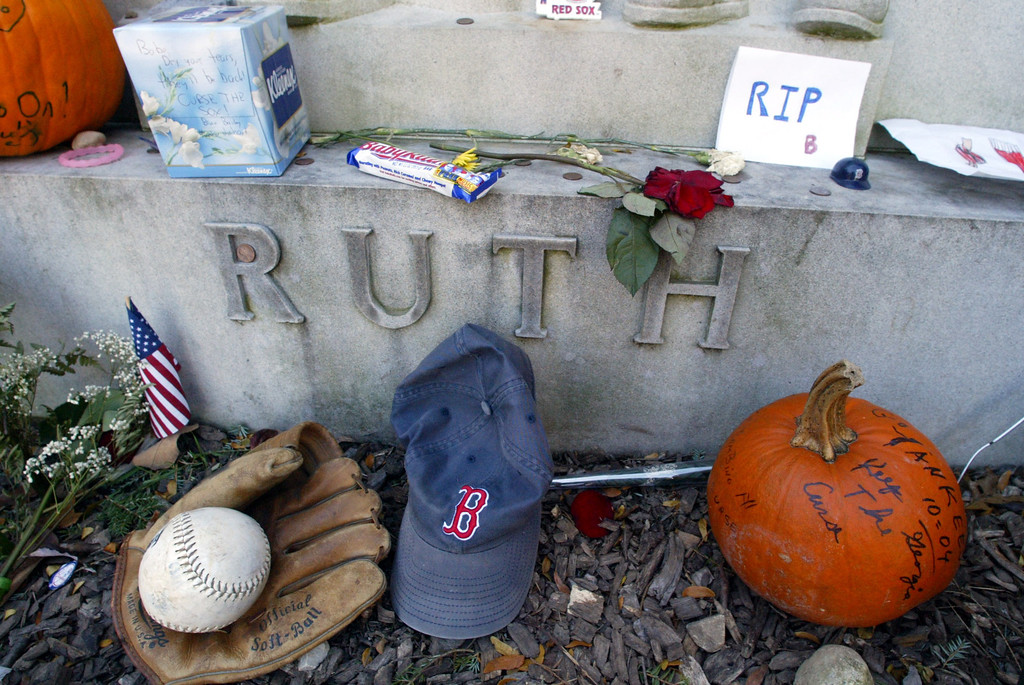 """. The grave of George Herman \'Babe\'\' Ruth is decorated with items left by New York Yankees and Boston Red Sox fans, Thursday, Oct. 28, 2004 in Hawthorne. The \""""Curse of the Bambino\"""" has followed Boston through four World Series defeats, each one in seven games. The end of the drought came Wednesday, Oct. 27, when Boston completed a sweep of the St. Louis Cardinals to win the World Series (AP Photo/Mary Altaffer)"""