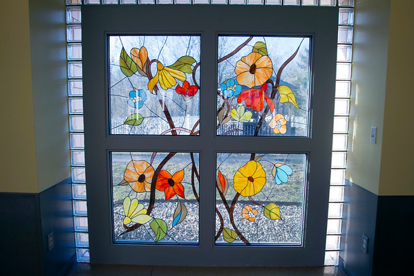 02/19/20 Wesley Bunnell | StaffrrA stained glass window off to the side of a common area at Monsignor Bojnowski Manor which features both long term and short term skilled nursing care.