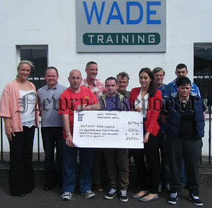 Pictured are members of WADE Training Newry presenting a cheque for £630.35 and €2.50 to Sarah Colgan, Regional Marketing Officer for the Southern Area Hospice. The group completed a 10-mile sponsored walk of the Towpath and donated the monies raised to the Hospice. Back l-r, Hannah Murtagh, Anthony McParland, Graeme Clarke, Donald Munro, Kenneth McCartan and Leo Boswell. Front l-r Geoffrey McMurray, Kevin Taylor, Sarah Colgan and Bridgeen O'Hare. R1436125