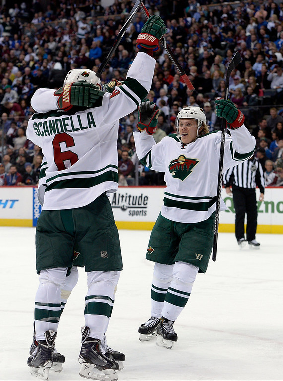 . Minnesota Wild left wing Dany Heatley (15), Marco Scandella (6) and center Mikael Granlund (64) celebrate Heatley\'s goal during the second period.  (Photo by John Leyba/The Denver Post)