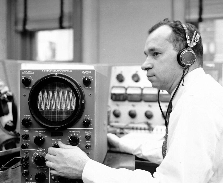 . This is the way the first minutes of the flight of the U.S. satellite Explorer I appears on the graph of an oscilloscope at the RCA office in New York, Jan. 31, 1958.  Signals from the satellite were recorded on tape and transposed on oscillograph.  The satellite was launched from Cape Canaveral, Fla., late tonight. Technician is unidentified. (AP Photo/Jacob Harris)