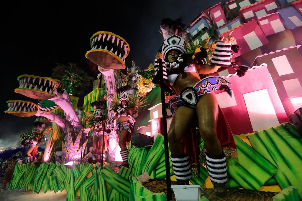 . Performers from the Paraiso do Tuiuti samba school parade on a float during Carnival celebrations at the Sambadrome in Rio de Janeiro, Brazil, Sunday, Feb. 26, 2017. (AP Photo/Silvia Izquierdo)